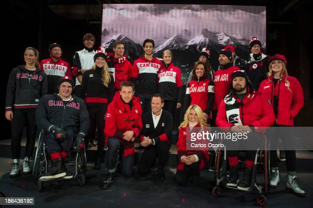 Olympic hopefuls pose for a group photograph at the unveiling of Canada's Olympic gear for the Winter Olympics in Sochi 2014 October 30 2013