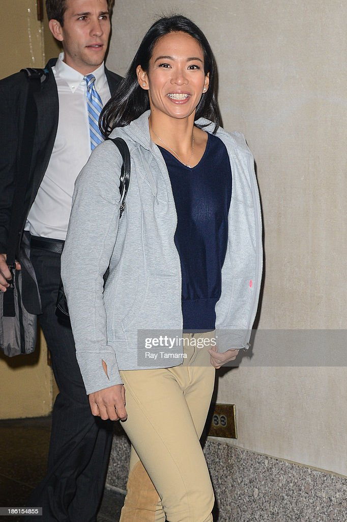 Olympic ice hockey player Julie Chu leaves the 'Today Show' taping at the NBC Rockefeller Center Studios on October 28, 2013 in New York City.