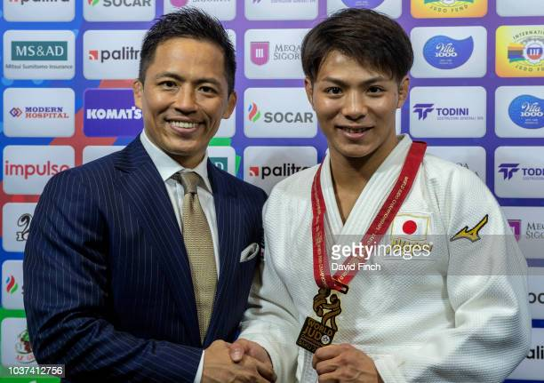 Olympic Judo legend with three gold medals to his credit Tadahiro Nomura of Japan congratulates Hifumi Abe on winning his second World gold medal at...