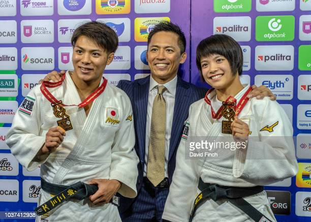 Olympic Judo legend with three gold medals to his credit, Tadahiro Nomura of Japan stands between brother and sister Hifumi Abe and Uta Abe after...