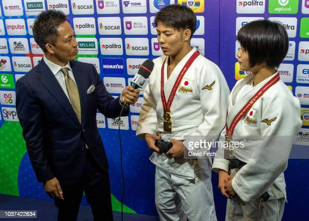 Olympic Judo legend with three gold medals to his credit Tadahiro Nomura of Japan interviews brother and sister Hifumi Abe and Uta Abe after they...