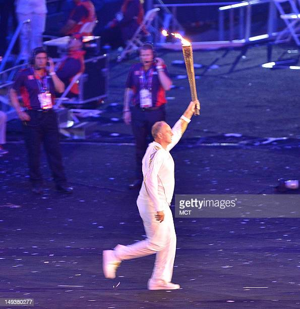 Olympic legend Steve Redgrave carries the Olympic flame into Olympic Stadium during the Opening Ceremony for the London 2012 Summer Olympic Games in...