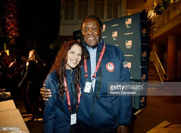 Olympic legends Tai Babilonia and Rafer Johnson celebrate the 2014 Sochi Olympics opening ceremony during the USOC's Team USA Club Night at the...