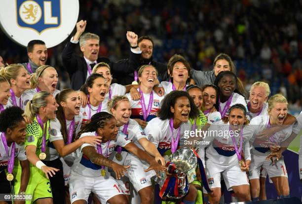 Olympic Lyon celebrate with the trophy after the UEFA Women's Champions League Final between Lyon and Paris Saint Germain at Cardiff City Stadium on...