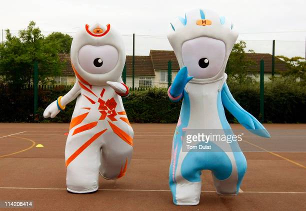 Olympic mascots pose for photographs during the Mayor's of London Boris Johnson and LOCOG Chairman's Lord Coe visit to The Compton School to call on...