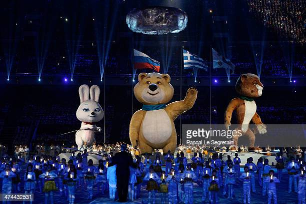 Olympic mascots the Hare, the Polar Bear and the Leopard stand by the extinguished Olympic flame during the 2014 Sochi Winter Olympics Closing...