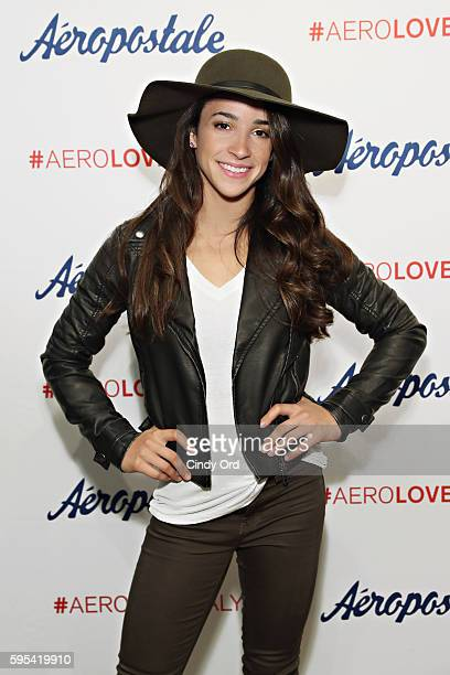 Olympic medalist Aly Raisman takes part in a fan meet and greet during a promotion for Aeropostale's Seriously Stretchy Denim at Aeropostale on...