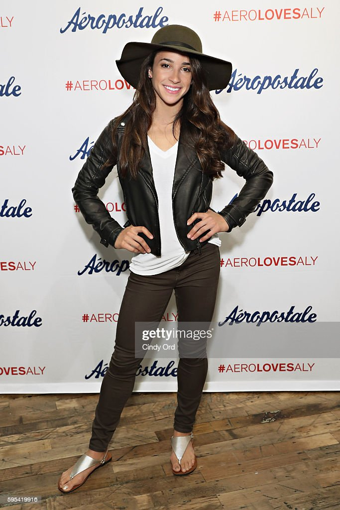 Olympic medalist aly raisman takes part in a fan meet and greet aly raisman for aeropostale news photo m4hsunfo