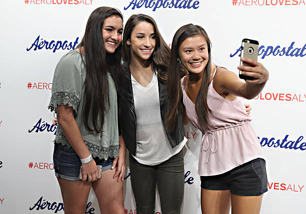 Aly raisman for aeropostale photos and images getty images olympic medalist aly raisman c takes part in a fan meet and greet during m4hsunfo
