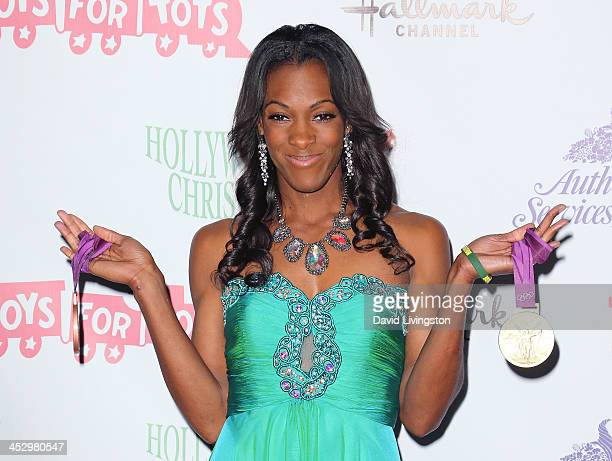 Olympic medalist DeeDee Trotter attends the Hollywood Christmas Parade benefiting the Toys for Tots Foundation on December 1 2013 in Hollywood...