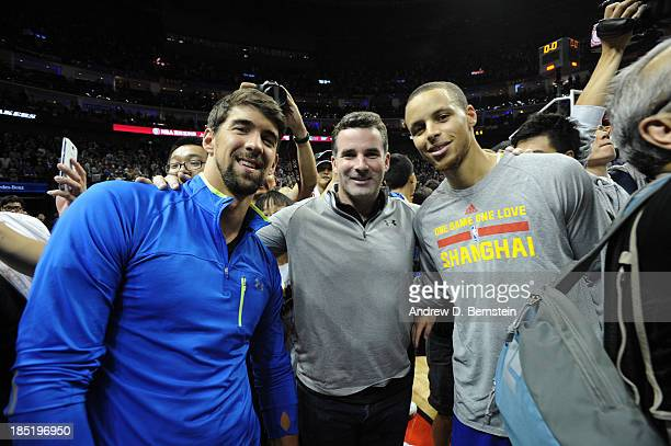 Olympic Medalist Michael Phelps Kevin Plank CEO of Under Armour and Stephen Curry of the Golden State Warriors poses for a photo after the 2013...