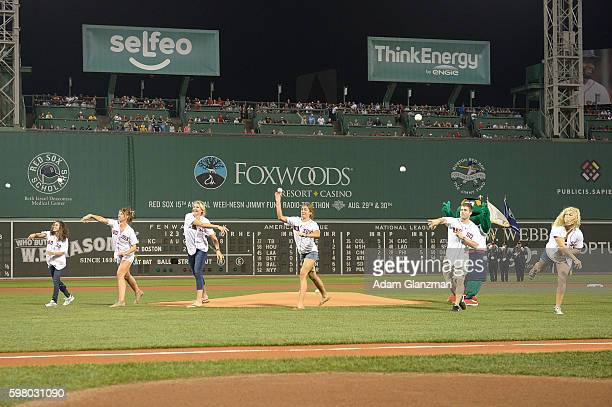 Olympic medalists Abbey D'Agostino Tessa Gobbo Eleanor Logan Genevra Stone Mike Hixon and Kayla Harrison throw out a ceremonial first pitch before a...