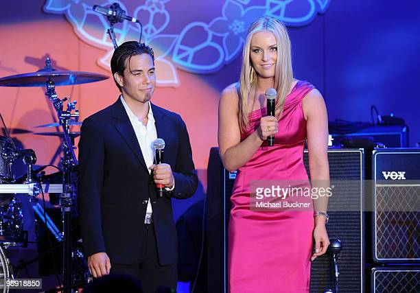 Olympic medalists Apollo Ohno and Lindsey Vonn speak onstage during the 17th Annual Race to Erase MS event cochaired by Nancy Davis and Tommy...