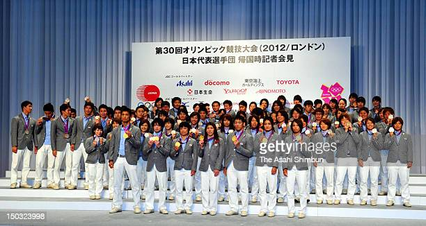 Olympic medalists pose for photos after the disbandment ceremony on August 14 2012 in Tokyo Japan