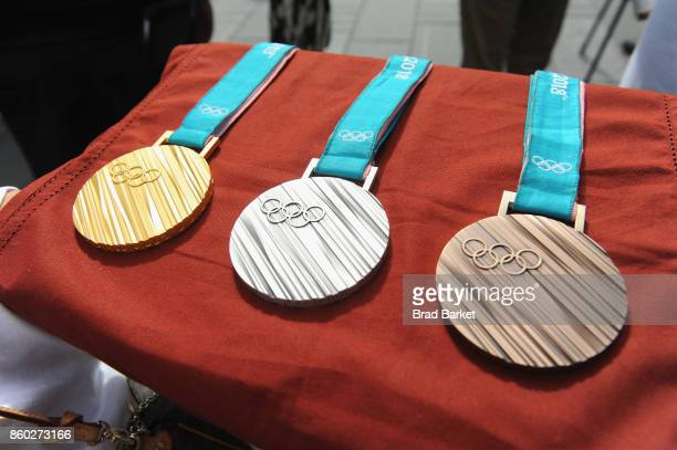 Olympic medals are seen during the PyeongChang 2018 Olympic Winter Games KickOff in Times Square on October 11 2017 in New York City