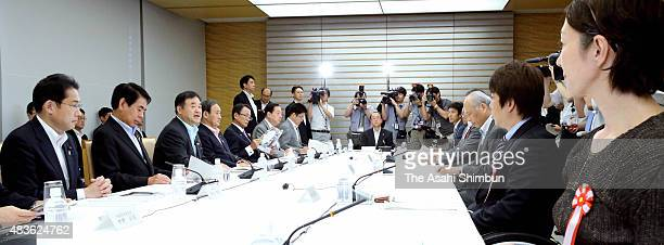 Olympic Minister Toshiaki Endo speaks during the New National Stadium Construction Plan ReExamination Meeting at Prime Minister Shinzo Abe's official...