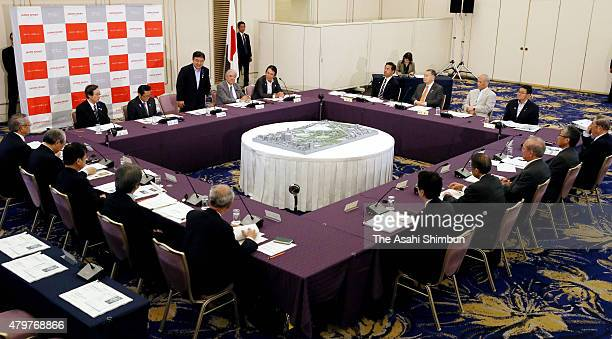 Olympic Minister Yoshiaki Endo greets during the New National Stadium Construction Experts Meeting on July 7 2015 in Tokyo Japan The total...
