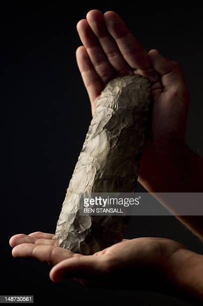 Olympic Park site engineer Danny Murphy holds a prehistoric flint axe head unearthed by archaeologists ahead of the construction of the Olympic Park...