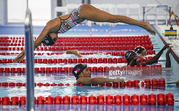 Olympic refugee team swimmer Yusra Mardini dives at the Olympic Aquatics Stadium ahead of the Rio 2016 Olympic Games on July 28, 2016 in Rio de...