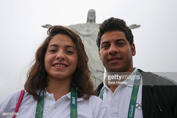 Olympic refugee team swimmers Yusra Mardini and Rami Anis pose for a photo in front of the Christ the Redeemer statue on July 30 2016 in Rio de...