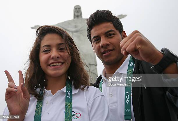 Olympic refugee team swimmers Yusra Mardini and Rami Anis pose for a photo in front of the Christ the Redeemer statue on July 30, 2016 in Rio de...