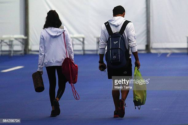 Olympic refugee team swimmers Yusra Mardini and Rami Anis walk to begin training at the Olympic Aquatics Stadium ahead of the Rio 2016 Olympic Games...