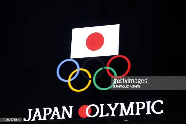 Olympic Rings and a Japan flag are seen on the Japan Olympic Museum building in Tokyo on January 8 as Tokyo Olympics organisers insisted that the...