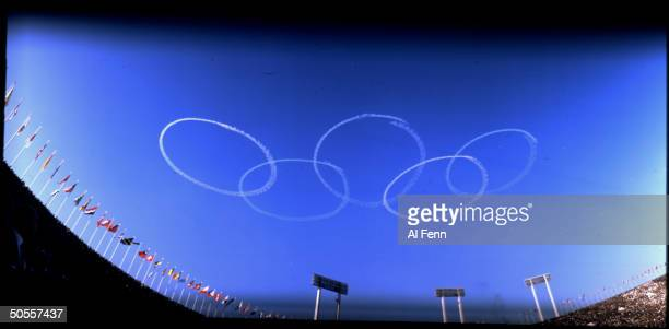 Olympic rings are formed in the sky by planes of the Japanese Self Defense Forces during opening ceremonies of the Summer Olympics