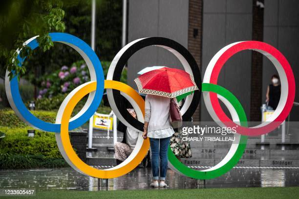 Olympic rings are pictured near the National Stadium, main venue for the Tokyo 2020 Olympic and Paralympic Games, in Tokyo on June 23, 2021.