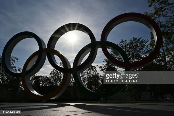 Olympic rings are pictured near the Olympic Stadium in Tokyo on May 22 2019 Japan will host the Tokyo 2020 Summer Olympics from July 24 to August 9...