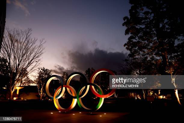 Olympic Rings are seen near the National Stadium, the main venue for the Tokyo 2020 Olympic and Paralympic Games, in Tokyo on January 8 as Tokyo...