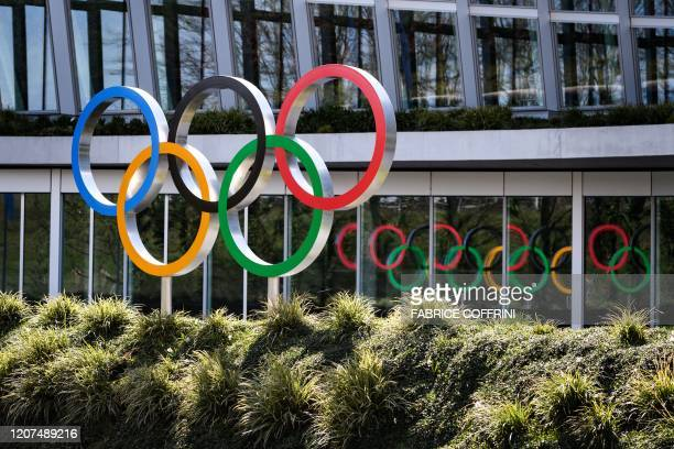 Olympic Rings are seen next to the headquarters of the International Olympic Committee in Lausanne on March 17 amid the spread of novel coronavirus...