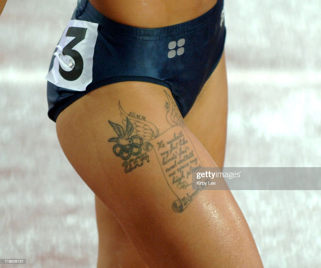 Olympic Rings, dove tattoo and biblical passage from the second book of Samuel on upper right thigh of 2004 Olympic women's 100-meter hurdle champion Joanna Hayes during the Women's 100m Hurdle Semifinals at the IAAF World Championships in Athletics at Olympic Stadium in Helsinki, Finland on Wednesday, August 10, 2005.