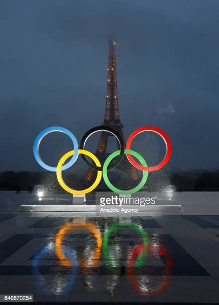 Olympic rings illuminate at place du Trocadero near the Eiffel Tower during the Paris 2024 Olympic bid victory celebrations in Paris France on...