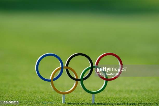 Olympic Rings is used as a tee mark in round 4 of the mens golf individual stroke play during the Tokyo 2020 Olympic Games at the Kasumigaseki...