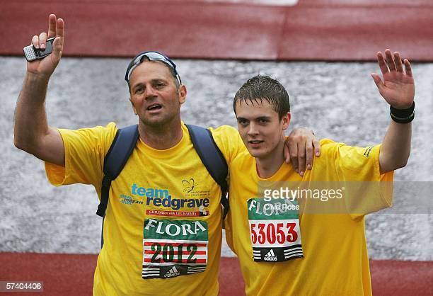 Olympic rower Sir Steve Redgrave and Ben Evans look on after finishing the 2006 Flora London Marathon on April 23 2006 in London England