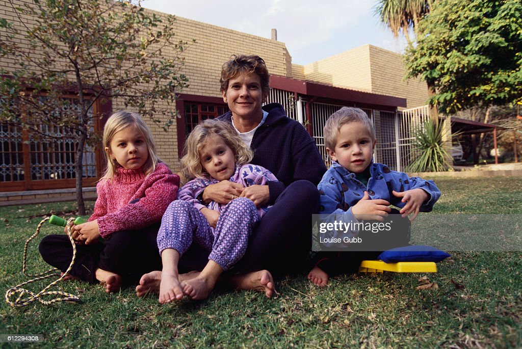 Olympic runner Zola Budd Pieterse with her children, five year old Lisa Pieterse and three year old twins Michael and Azelle Pieterse.