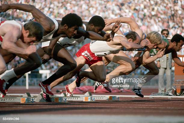 Olympic runners come out of the blocks at the start of the 100 meter sprint at the 1976 Summer Olympics
