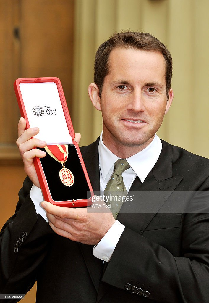 Olympic sailor Sir Ben Ainslie proudly holds his Knighthood award after the Investiture Ceremony at Buckingham Palace on March 07, 2013 in London, England.