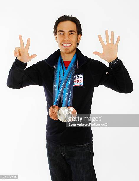 Olympic short track speed skater Apolo Anton Ohno of the United States with his two bronze medals for the men's 1000m and men's 5000m relay and...