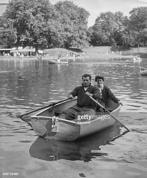 Olympic shot putter Arthur Rowe in a rowing boat with fellow Olympian sprinter Dorothy Hyman relaxing following the Festival of Labour in Battersea...