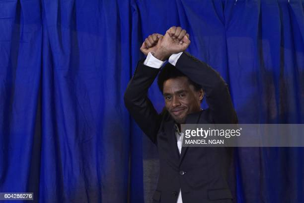 Olympic silver medalist marathoner Feyisa Lilesa of Ethiopia arrives for a press conference at a hotel in Washington DC on September 13 2016...