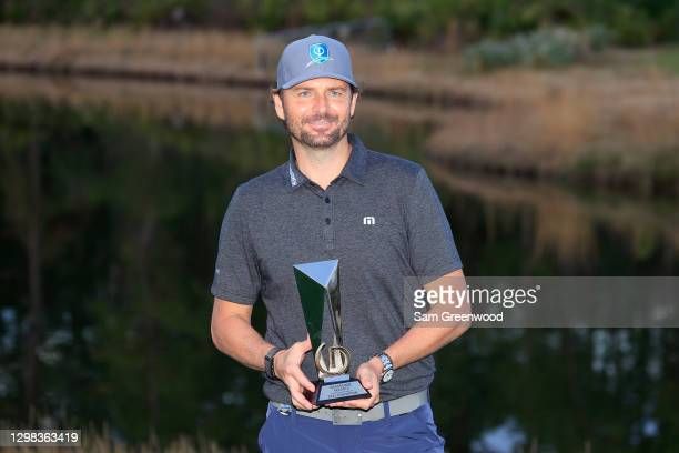Olympic silver medalist Mardy Fish poses with the trophy after winning the celebrity division of the Diamond Resorts Tournament of Champions at...