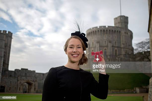 Olympic skeleton champion Lizzy Yarnold after being awarded an MBE by Queen Elizabeth II following an investiture ceremony at Windsor Castle on...
