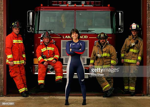 Olympic Skeleton racer Lea Ann Parsley who is a volunteer firefighter poses for a portrait with Lake Placid firefighters Brad Jaques Matt Colby Todd...