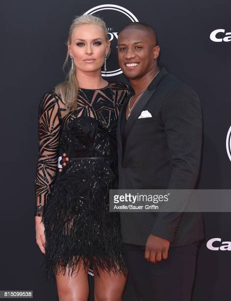 Olympic skier Lindsey Vonn and former NFL coach Kenan Smith arrive at the 2017 ESPYS at Microsoft Theater on July 12 2017 in Los Angeles California