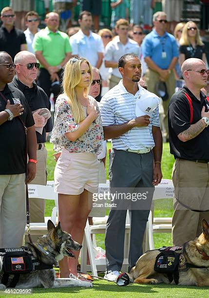 Olympic skier Lindsey Vonn and Tiger Woods are seen together during the Opening Ceremony for the Quicken Loans National at Congressional Country Club...