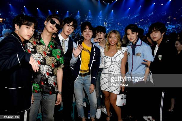 Olympic snowboarder Chloe Kim poses with musical group BTS at the 2018 Billboard Music Awards at MGM Grand Garden Arena on May 20 2018 in Las Vegas...