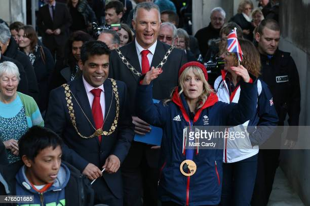 Olympic Snowboarder Jenny Jones waves to the crowd as she completes a bus tour of her home city to celebrate her success in the Sochi Winter Olympics...