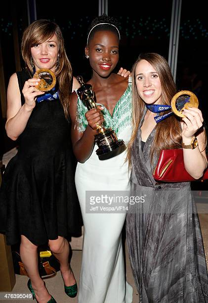 Olympic snowboarder Kaitlyn Farrington actress Lupita Nyong'o and olympic skier Maddie Bowman attend the 2014 Vanity Fair Oscar Party Hosted By...